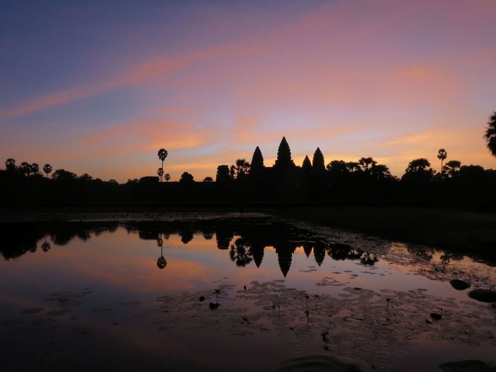 Silhouette angkor wat during sunrise