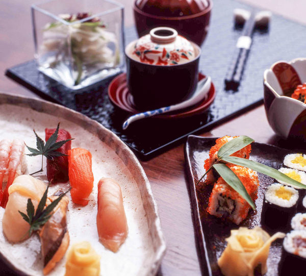 High angle view of sashimi and sushi served on table