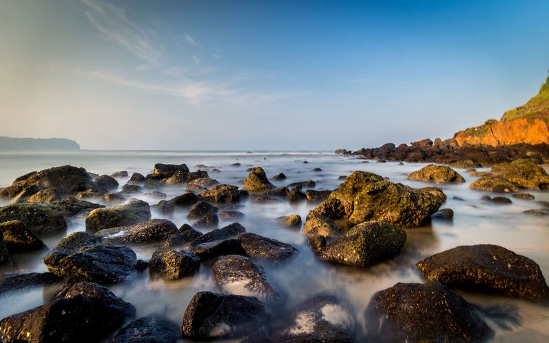 Beauty In Nature Day Horizon Over Water Long Exposure Motion Nature No People Outdoors Pebble Beach Rock - Object Scenics Sea Sky Sunset Tranquil Scene Tranquility Water