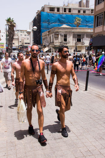 Tel Aviv, Israel, June 03, 2016: Members of the traditional yearly pride parade surrounded by other people in Tel Aviv, Israel Actions Celebrations Civil Colored Colors Cultures Endurance Flag Focus Freedom Gay Holidays Homosexual Love Lesbian Lifestyles Motion Multi Parade Pride Scene Selective Street Symbol Transgender Transsexual