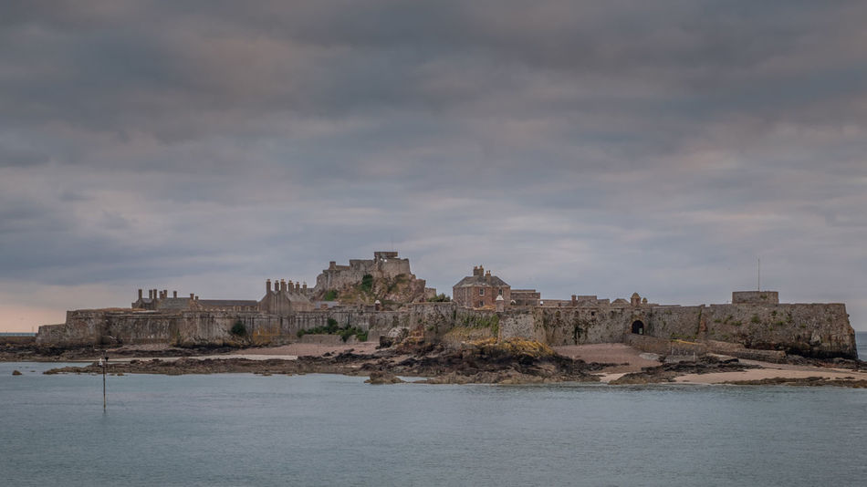 Channel Islands Elizabeth Castle, Jersey Architecture Building Building Exterior Built Structure Cloud - Sky Day History Land Nature No People Outdoors Scenics - Nature Sea Sky The Past Travel Travel Destinations Water Waterfront