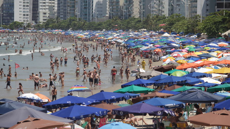 People at beach in city