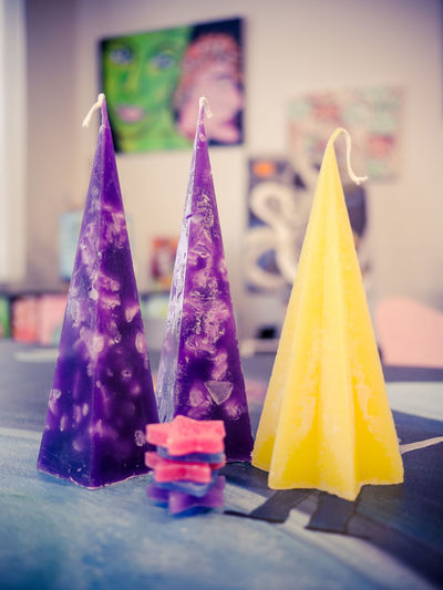 hand made candles and wax stars Pyramid Hand Made Crafted Candles Candle Making Yellow Purple Stars Wax Close-up