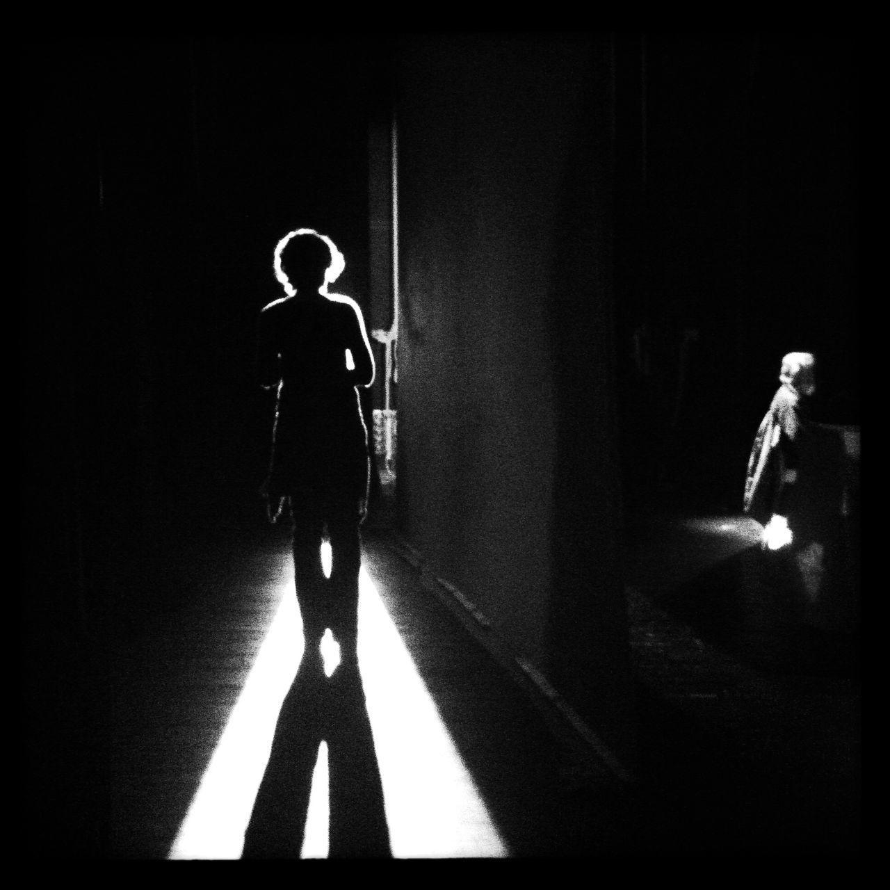 Silhouette woman walking in the dark