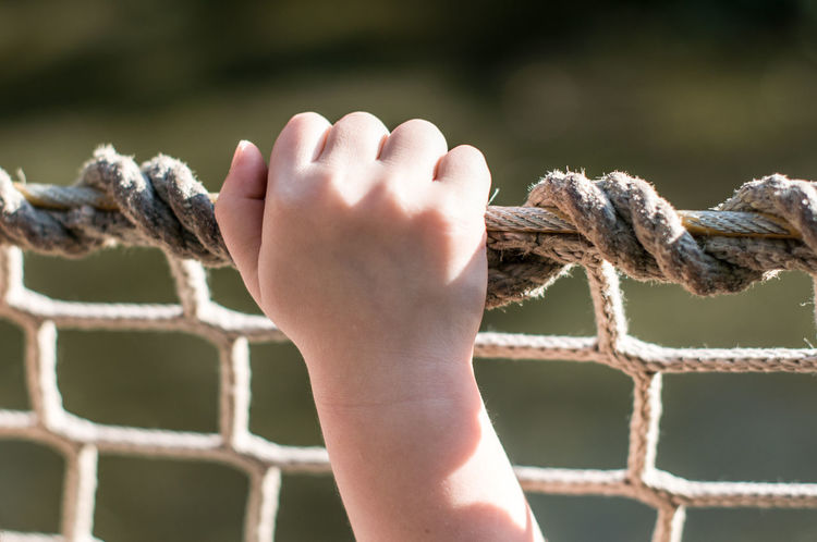 Child Human Body Part One Person Finger Close-up Outdoors Human Hand Sun Hand Knot Fishernet Summer Day Nature Child Hands Children Only Border People Life Kids Fist Fishing Jail Boy Girl