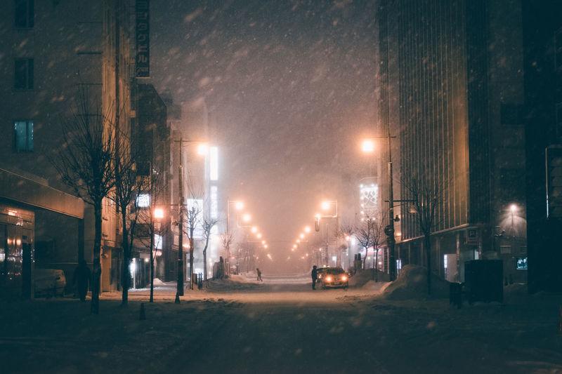 Empty streets during a snowstorm // IG: @taromoberly Snow Snowing Winter Night Street Street Light Illuminated City Road Snowstorm Hokkaido Japan Japan Photography Travel Travel Photography Night Lights Deserted No People Dark Desolate