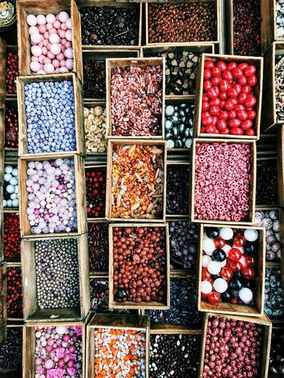 High Angle View Of Colorful Pearls In Boxes At Market For Sale