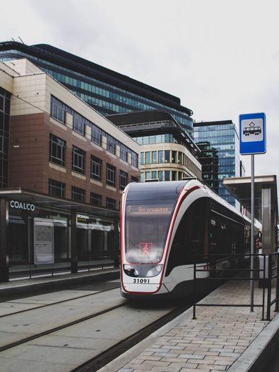 Train on city street against sky