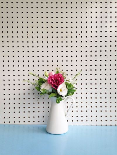 Flower Freshness Fragility Indoors  Nature No People Flower Head Flower Arrangement Beauty In Nature Close-up Bouquet Day Minimalism Deceptively Simple Lifestyles Pegboard Blue Background Freshness Flowers On Table Flowers In A Vase Flowers In Bloom Flower Arrangement White Background Simplicity Pink Flower