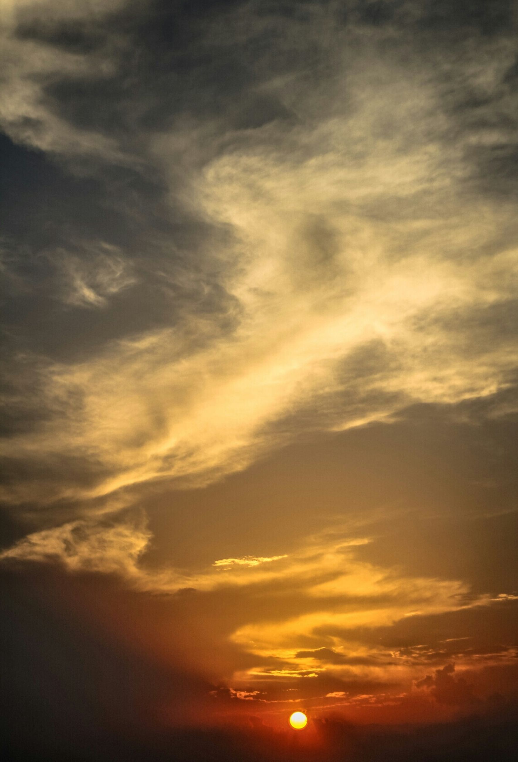 sunset, sky, scenics, beauty in nature, tranquility, tranquil scene, orange color, cloud - sky, idyllic, nature, low angle view, sun, sky only, dramatic sky, silhouette, cloudscape, cloudy, majestic, backgrounds, cloud