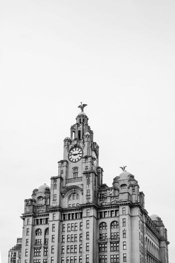 Low angle view of royal liver building against clear sky