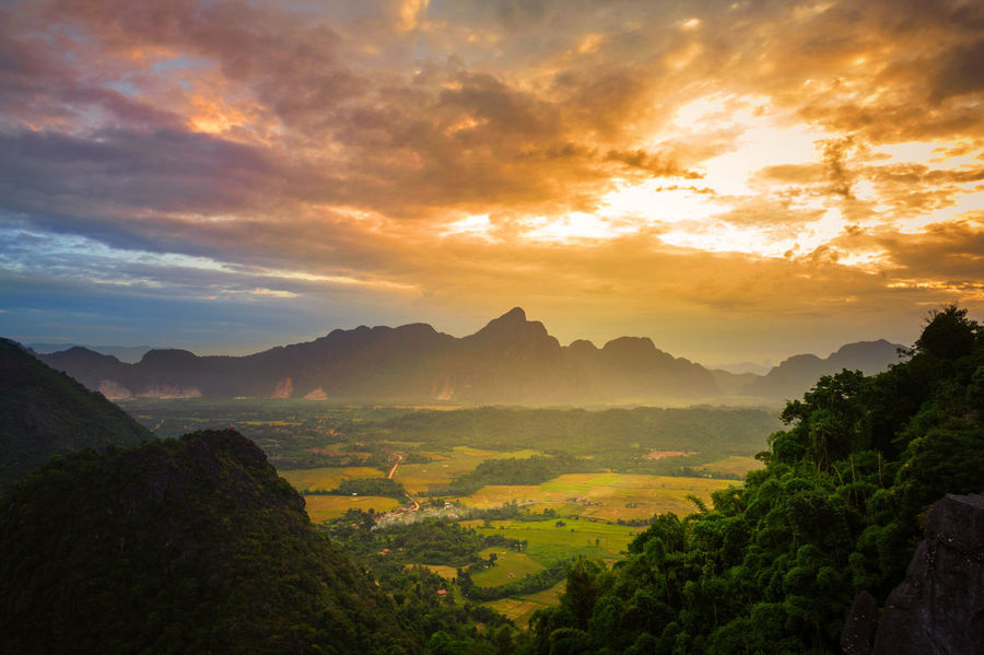 Beautiful landscape sunset from top view on the moutain of vang vieng, laos Hiking Morning Agriculture Beauty In Nature Cloud - Sky Day Dusk Field Hiksunlight Hill Landscape Mountain Nature No People Outdoors Rock, Gravel, Sand Rural Scene Scenics Sky Sunrise Sunset Tranquil Scene Tranquility Tree Valley