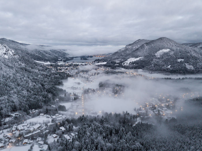 Aerial view of snow covered mountains against sky