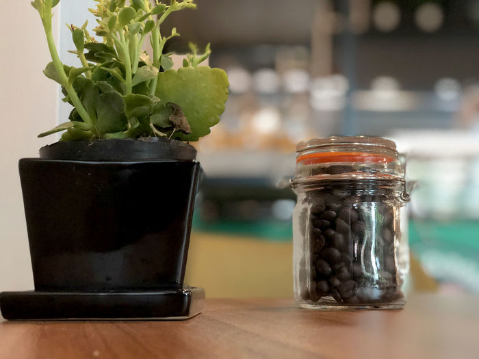 Close-up of coffee beans in glass jar on table