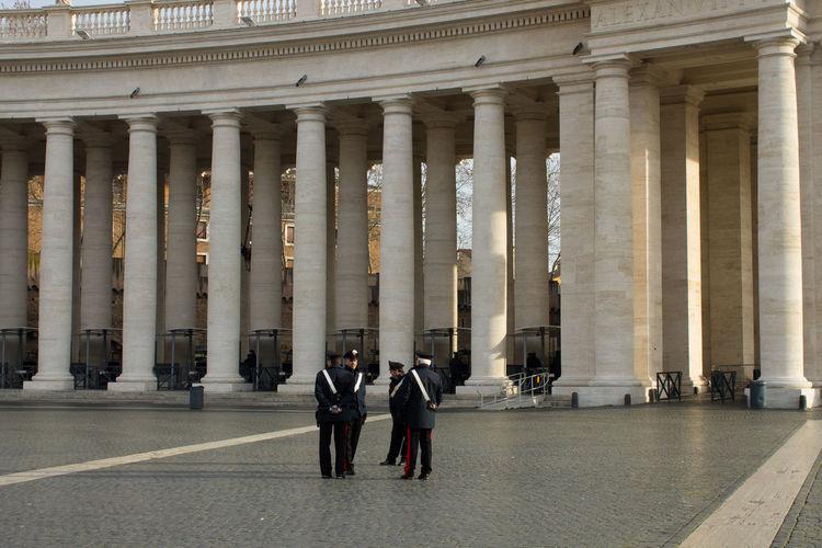 Men standing in front of historical building