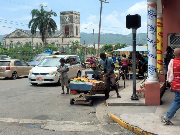 Street Vendors in Montego Bay, Jamaica Architecture Built Structure Car Casual Clothing Day Fruit Jamaica Lifestyles Men Montego Bay Jamaica Outdoors Person Road Sky Street Street Corner Street Vendors