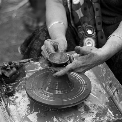 Potter at work Art Art And Craft Artist Black And White Ceramics Close-up Craft Creativity Cropped Earthenware Focus On Foreground Hands Hands At Work Hands On High Angle View Human Body Part Indoors  Part Of Person Pottery Real People Sculpture Skill  Terracotta Unrecognizable Person