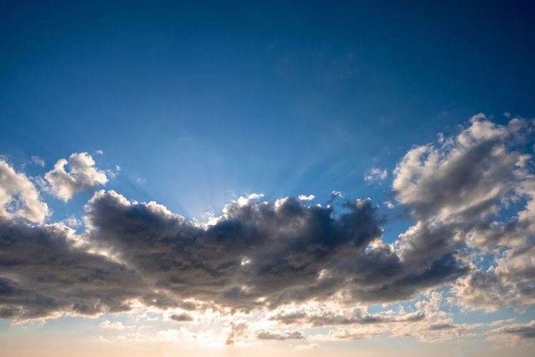 Backgrounds Beauty In Nature Blue Cloud - Sky Cloudscape Day Dramatic Sky Environment Heaven Idyllic Low Angle View Nature No People Outdoors Scenics Sky Sky Only Sunlight Sunset Tranquil Scene Tranquility Weather