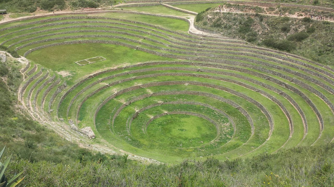 old ruin, history, ancient, archaeology, ancient civilization, day, travel destinations, outdoors, green color, high angle view, travel, no people, nature, field, tourism, terraced field, tranquility, mountain, beauty in nature