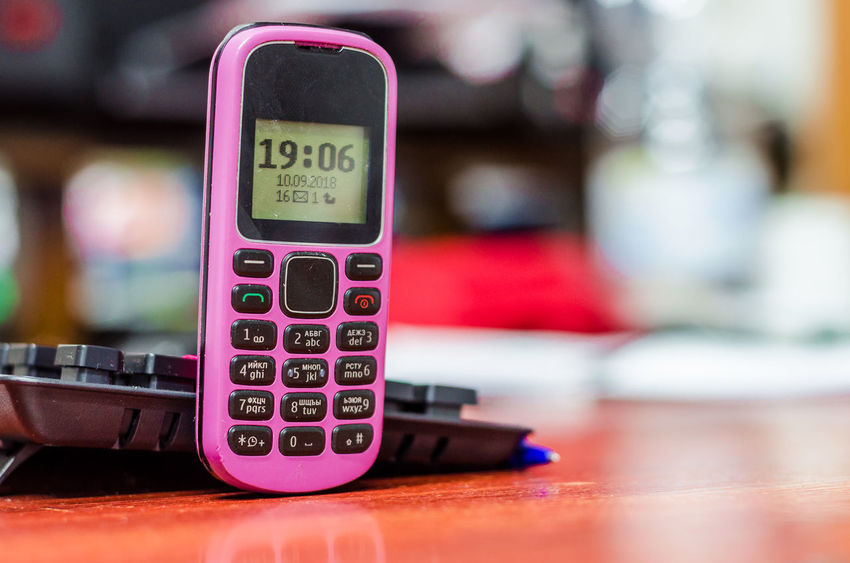 Close-up Communication Connection Control Day Focus On Foreground Illuminated Indoors  No People Number Pink Color Push Button Selective Focus Still Life Table Technology Text Western Script Wireless Technology