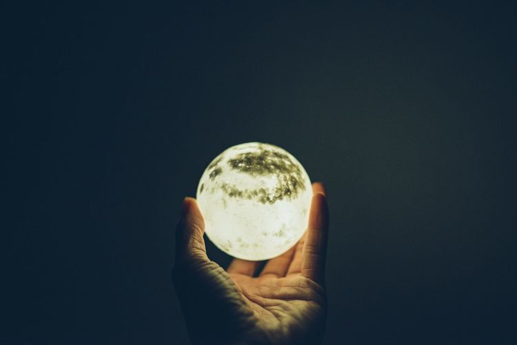 Close-up of hand holding glass ball