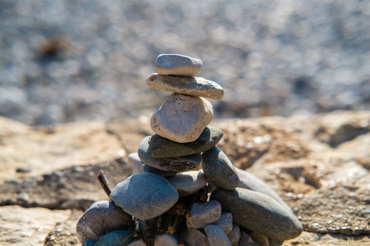 Life in balance Stone - Object Balance Solid Rock Stack Land Nature Pebble Focus On Foreground Day No People Rock - Object Stone Sunlight Zen-like Outdoors Close-up Field Beach Stability Balance And Composure Tranquility Tranquility Scene Minimalism Simplicity