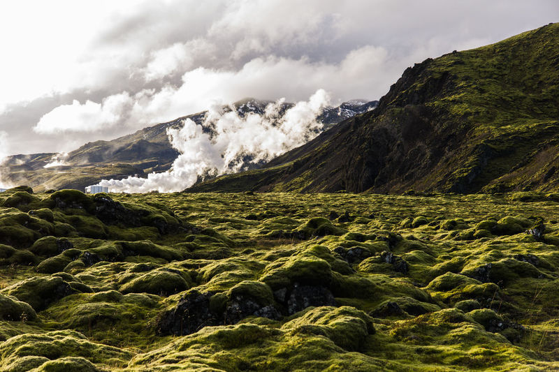 Scenic view of volcanic landscape against sky, ion hotel, iceland.