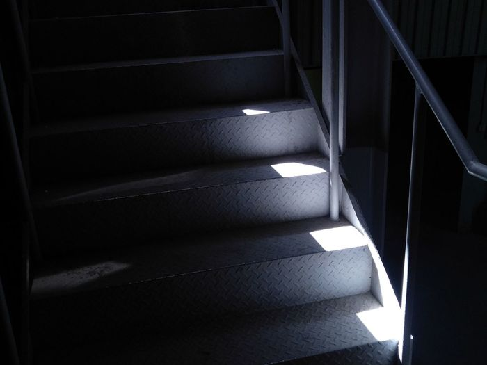 Cropped Image Of Partially Illuminated Steel Staircase