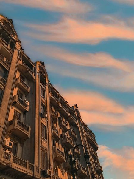 Downtown Cairo EyeEm Selects Sky Cloud - Sky Building Exterior Built Structure Architecture Low Angle View Dusk Orange Color Outdoors Beauty In Nature Travel No People Travel Destinations Tourism Sunset Residential District Nature City Building