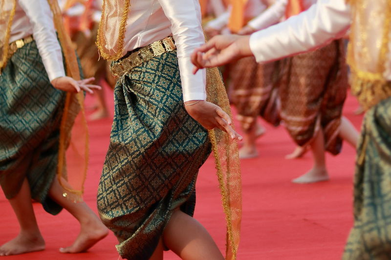 Women wearing traditional clothing dancing