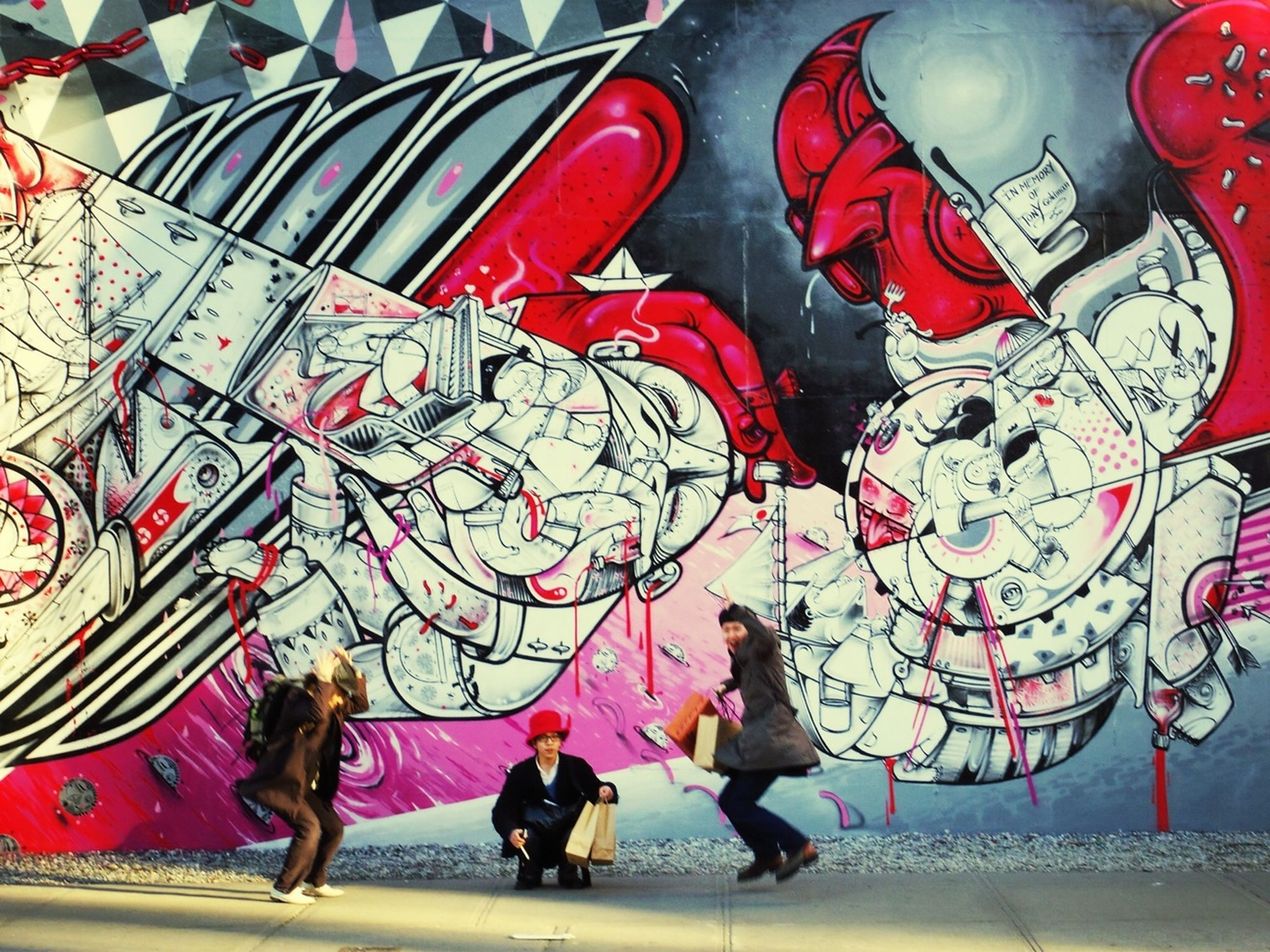 art, art and craft, creativity, graffiti, human representation, lifestyles, leisure activity, multi colored, red, animal representation, men, person, full length, built structure, cultures, wall - building feature, architecture, day