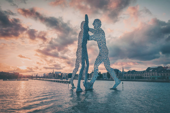 Molecule man in Berlin / Germany Art Berlin City Berlin Germany Berlin, Germany  Cloud Cloud - Sky Cloudy Dramatic Sky Germany Leisure Activity Lifestyles Molecule Man Nature Orange Color Outdoors Sky Skyline Stormy Sky Stormy Sunset Sunset Tourism Travel Destinations Urban Icon Vacations Water