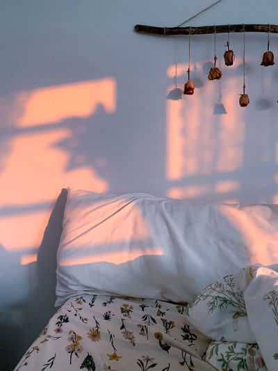 Aerial view of clothes hanging on bed against sky during sunset