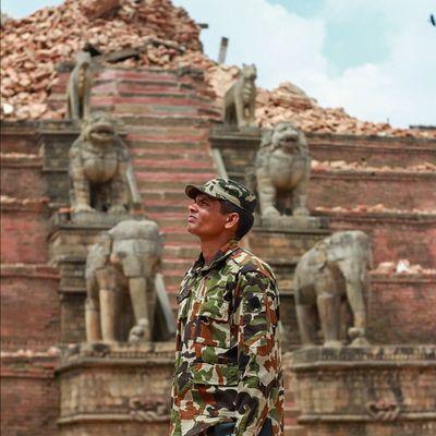 An army personnel looks towards the debris of the temple in Bhaktapur EARTHQUAKES Earthquakesurvivors Nepal Nepalearthquake2015 Bhaktapur Buildingbacknation Rebuildingnepal