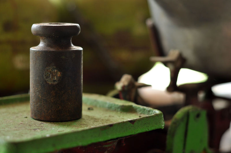 Scale Machine Focus On Foreground Close-up Metal No People Day Still Life Old Container Rusty Table Selective Focus Outdoors Nature Safety Green Color Machinery Sunlight Security Steel Alloy Scale