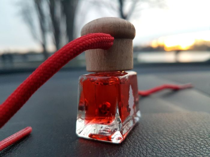 Close-up of little glass bottle with red liquid
