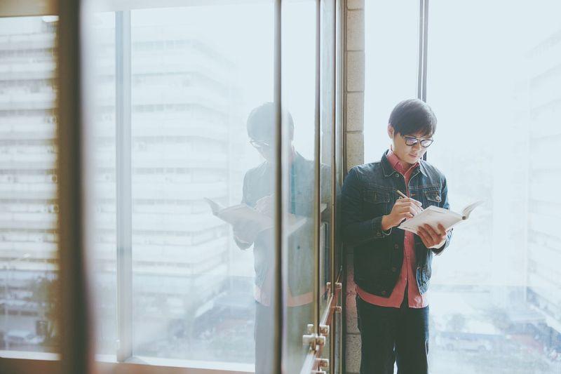 Book Books Boy Bright Casual Clothing Copywriter Day Daytime Denim Guy Japanese Style Leisure Activity Lifestyles Portrait Pose Potrait Window Windows Writing