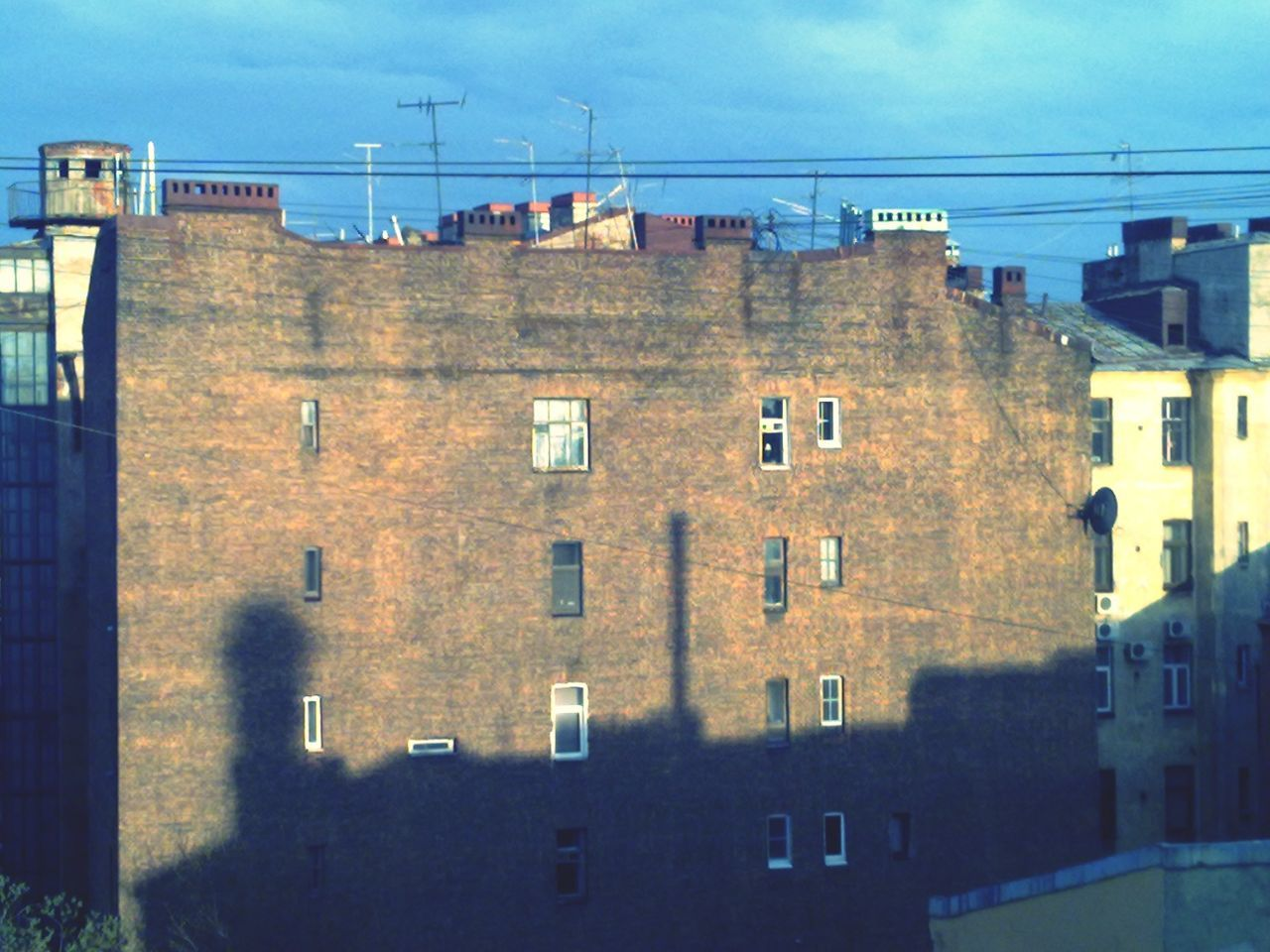 architecture, building exterior, built structure, window, sky, no people, day, residential building, cloud - sky, outdoors, cable, prison