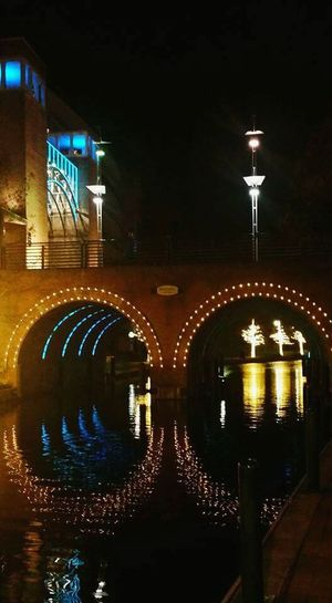 The Culture Of The Holidays Bridge - Man Made Structure Architecture Built Structure Illuminated Arch Night Water Reflection Arch Bridge River City Bridge Outdoors Arched Photography EyeEm Gallery Colorful Christmas2015 Popularphotos EyeEm Best Shots Traditional Culture Multi Colored Overnight Success
