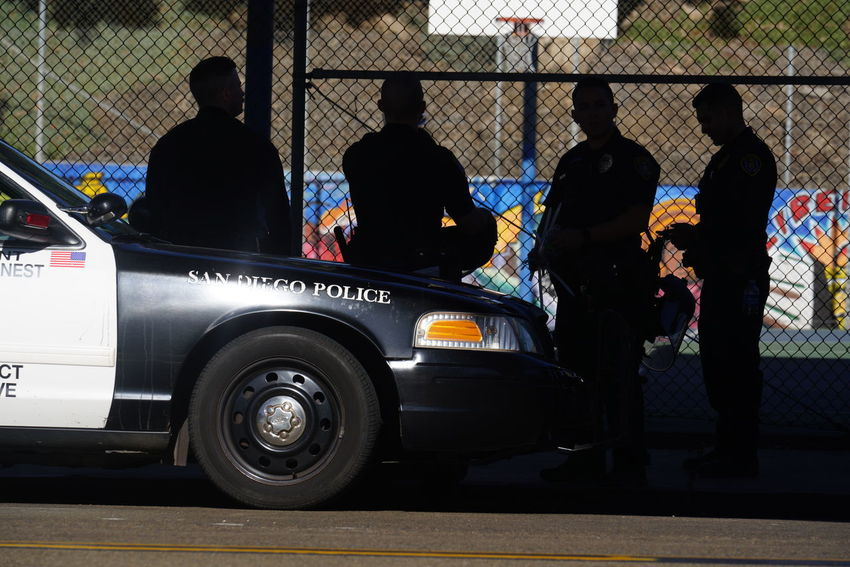 Copy Space Enforcement Government Law And Order  Officer San Diego Police Car Cop Street Enforce Policd Enforcement Order Group Male Neighborhood Officers Police Police Car Police Enforcement Police Force Police Gathering Police Officers Police San Diego Popo Protection Street Street Cops
