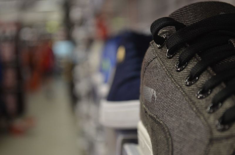 Trainer Close-up Clothing Day Focus On Foreground Land Vehicle Outdoors Pattern Real People Seat Selective Focus Shoe Sneakers Still Life Textile Transportation Wheel