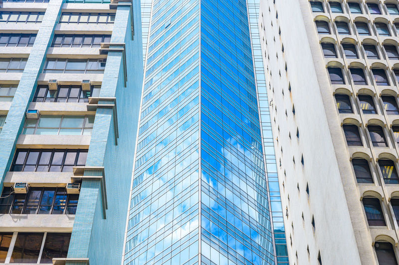 Low angle view of modern glass building in city