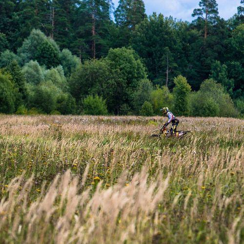 Man cycling in field