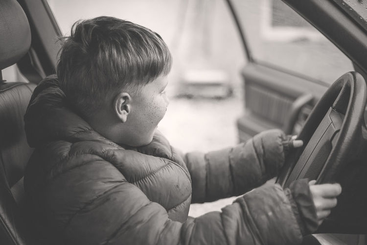 Car Car Interior Childhood Close-up Communication Day Holding Indoors  Journey Land Vehicle Mode Of Transport One Person People Real People Retro Styled Sitting Technology Transportation Vehicle Interior Vehicle Seat An Eye For Travel This Is Family