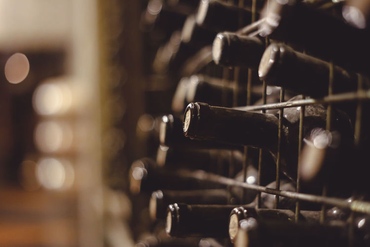 Close-up of old wine bottles in cellar