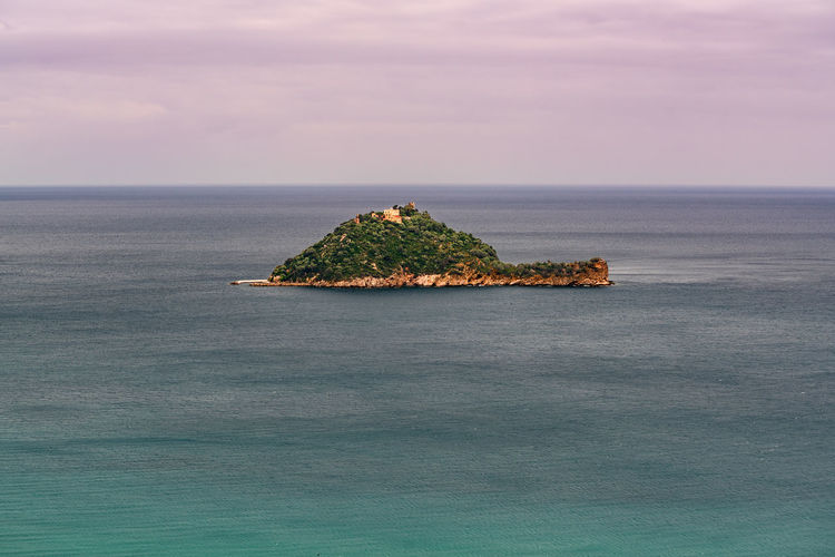 Gallinara or Isola d'Albenga lies in the Ligurian Sea off the coast of Albenga in the Province of Savona, Liguria, Italy. Sea Water Horizon Over Water Scenics - Nature Beauty In Nature Sky Horizon Waterfront Tranquil Scene Tranquility Idyllic Nature No People Non-urban Scene Outdoors Day Rock Tree Plant Turquoise Colored Stack Rock Gallinara Isle Gallinara Alassio Liguria Alassio Italy Beauty