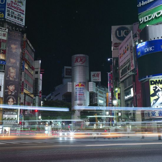 Illuminated Night Building Exterior Architecture Built Structure Speed Motion Blurred Motion Transportation Road City Long Exposure Light Trail Street Outdoors Travel Destinations City Life Urban Scene Tall High Street Tokyo Street Photography Hasselblad