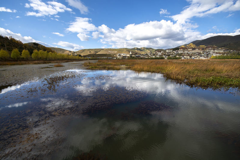 Water Sky Cloud - Sky Scenics - Nature Tranquil Scene Tranquility Beauty In Nature Reflection Mountain Lake Nature Non-urban Scene No People Day Waterfront Environment Idyllic Landscape Outdoors Reflection Lake Tibet China