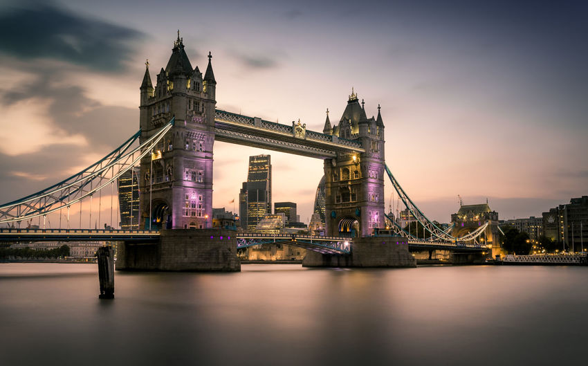 A long exposure of Tower Bridge at sunset from the south of the rive, with the City of London in the background. Amazing Architecture Beautiful Bridge - Man Made Structure Built Structure City Cityscape Cloud - Sky Colors Connection Day Dramatic Sky Gherkin Horizontal London London Bridge River Sky Skyscraper Sunset Tourism Tower Bridge  Travel Travel Destinations Urban Skyline