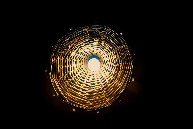Dark Darkness Black Background Circle Darkness And Light Illuminated Lamp Long Exposure Motion Night No People Outdoors Warm